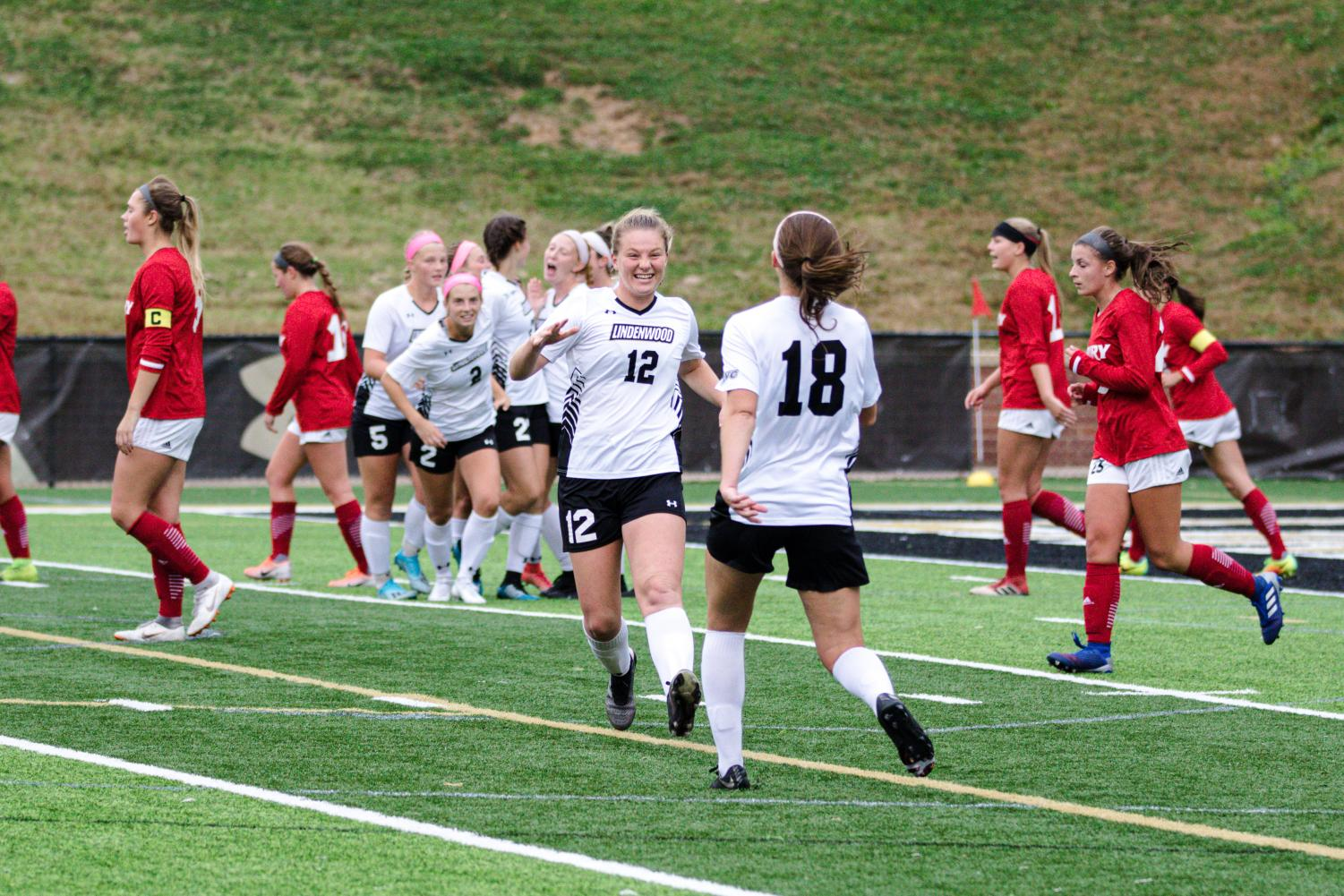 Lion's Jill Wipke (12) runs to celebrate with Alaina White after Lindenwood leads 1-0 against Drury Panthers. Photo by James Tananan Kamnuedkhun
