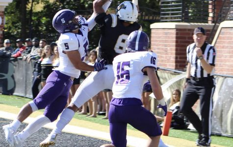 No. 5 Zach Nadle and no. 16 Ben Watson try to steal the ball from senior Erik Henneman who successfully completed the touchdown against Truman State during Homecoming Day at Harlen C. Hunter Stadium.
