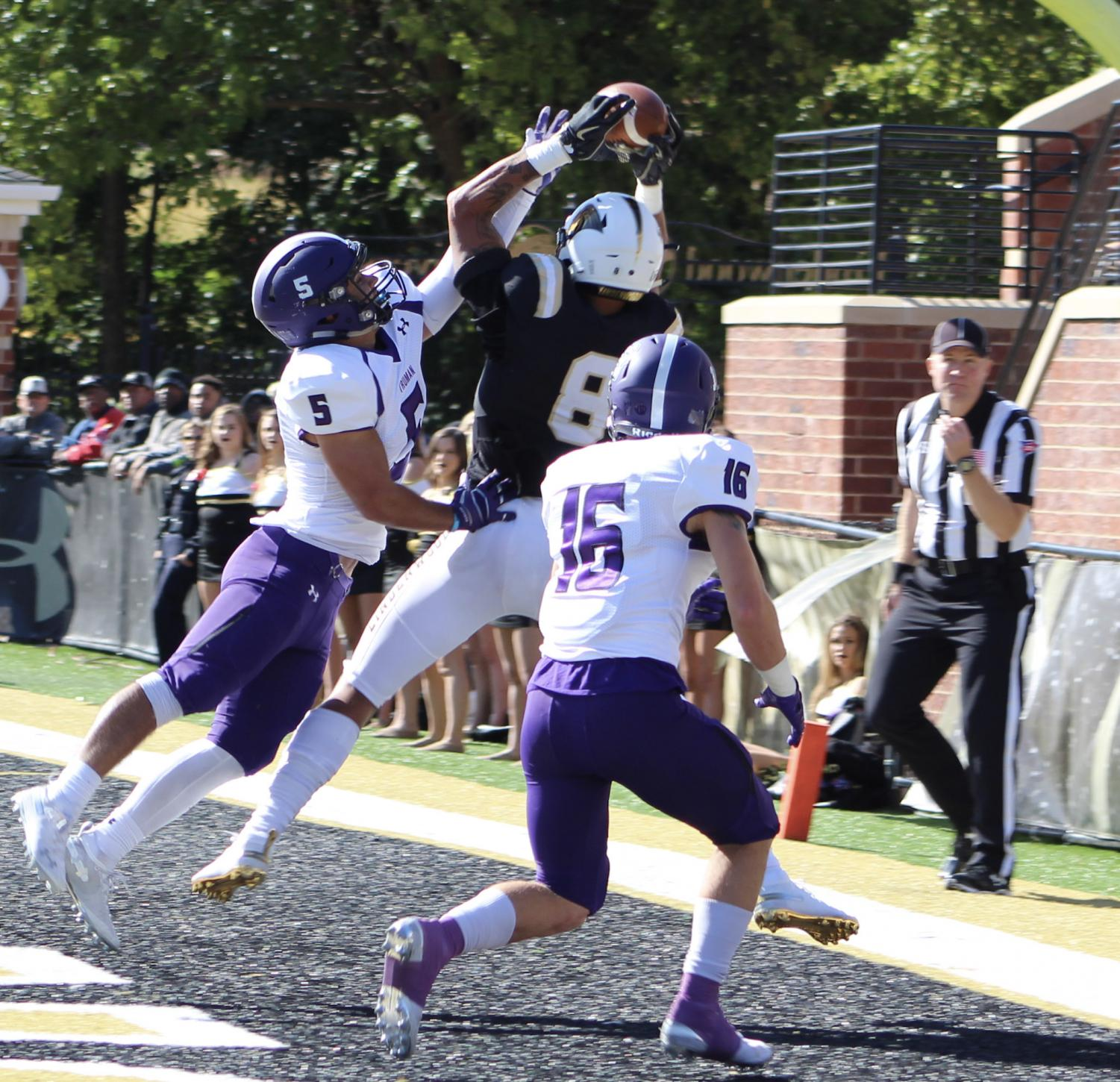 No. 5 Zach Nadle and no. 16 Ben Watson try to steal the ball from senior Erik Henneman who successfully completed the touchdown against Truman State during Homecoming Day at Harlen C. Hunter Stadium  Photo by Caleb Riordan.