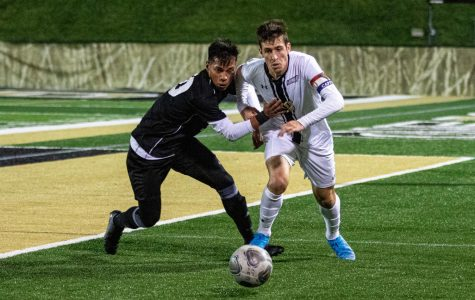 Lions junior Leon Silva (right) gets tackled by Hector Marin. The Lions played to a 0-0 draw against the Drury Panthers.
