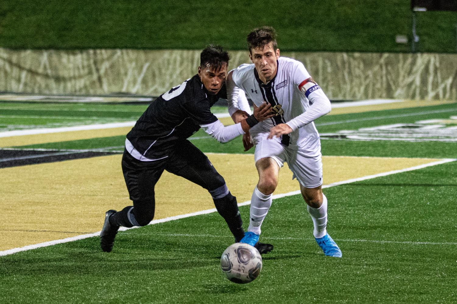 Lion's junior Leon Silva (white) got tackled by Hector Marin (black) The Lions draw 0-0 against Drury Panthers. Photo by James Tananan
