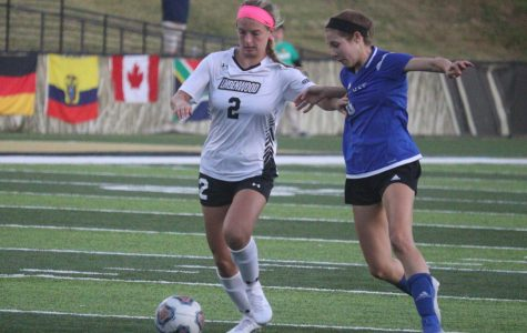 Katie Juhlin dribbles past a Rockhurst University defender during Friday's 1-0 win at Harlen C. Hunter Stadium.