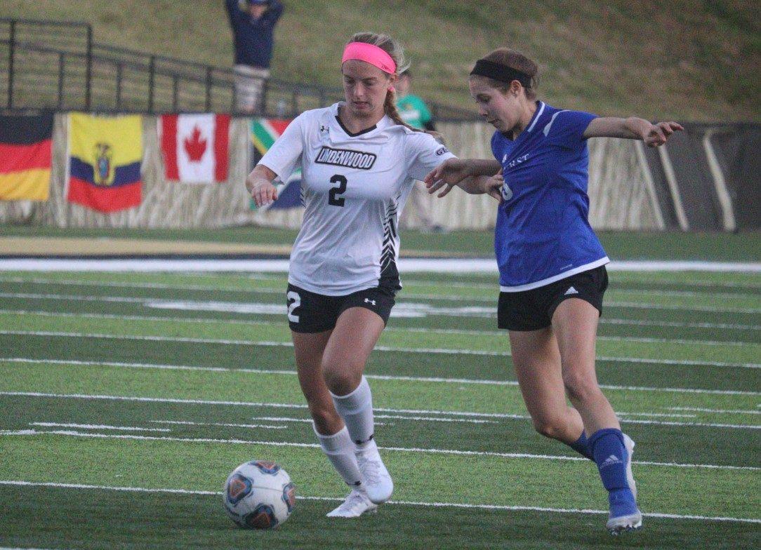 Katie Juhlin dribbles past a Rockhurst University defender during Friday's 1-0 win at Harlen C. Hunter Stadium.  Photo by Billy Woods
