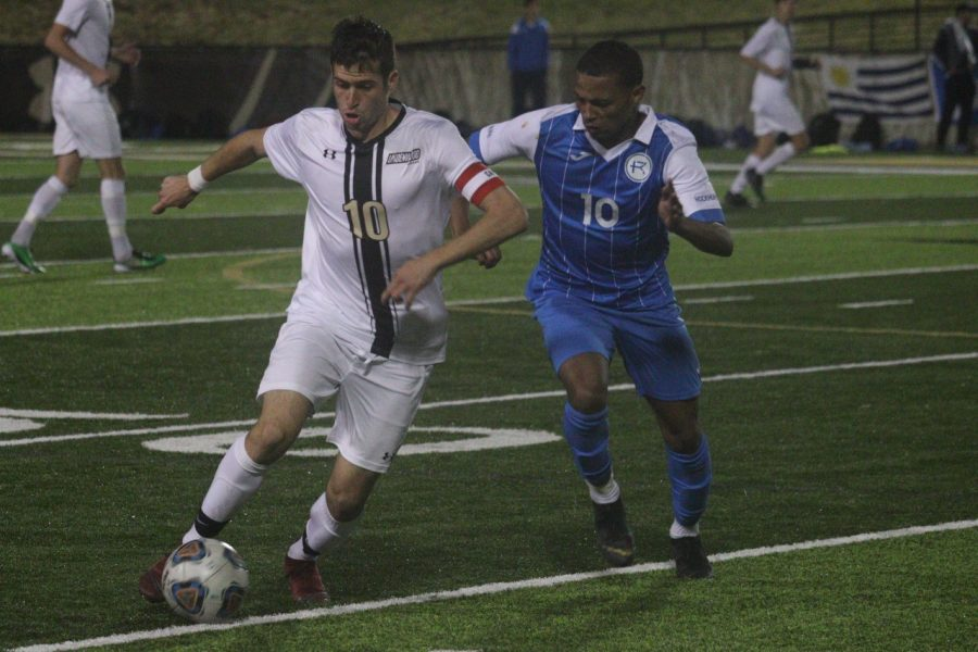 Leon Silva fights for possession of a ball against a Rockhurst University player during Friday's match at Harlen C. Hunter Stadium.