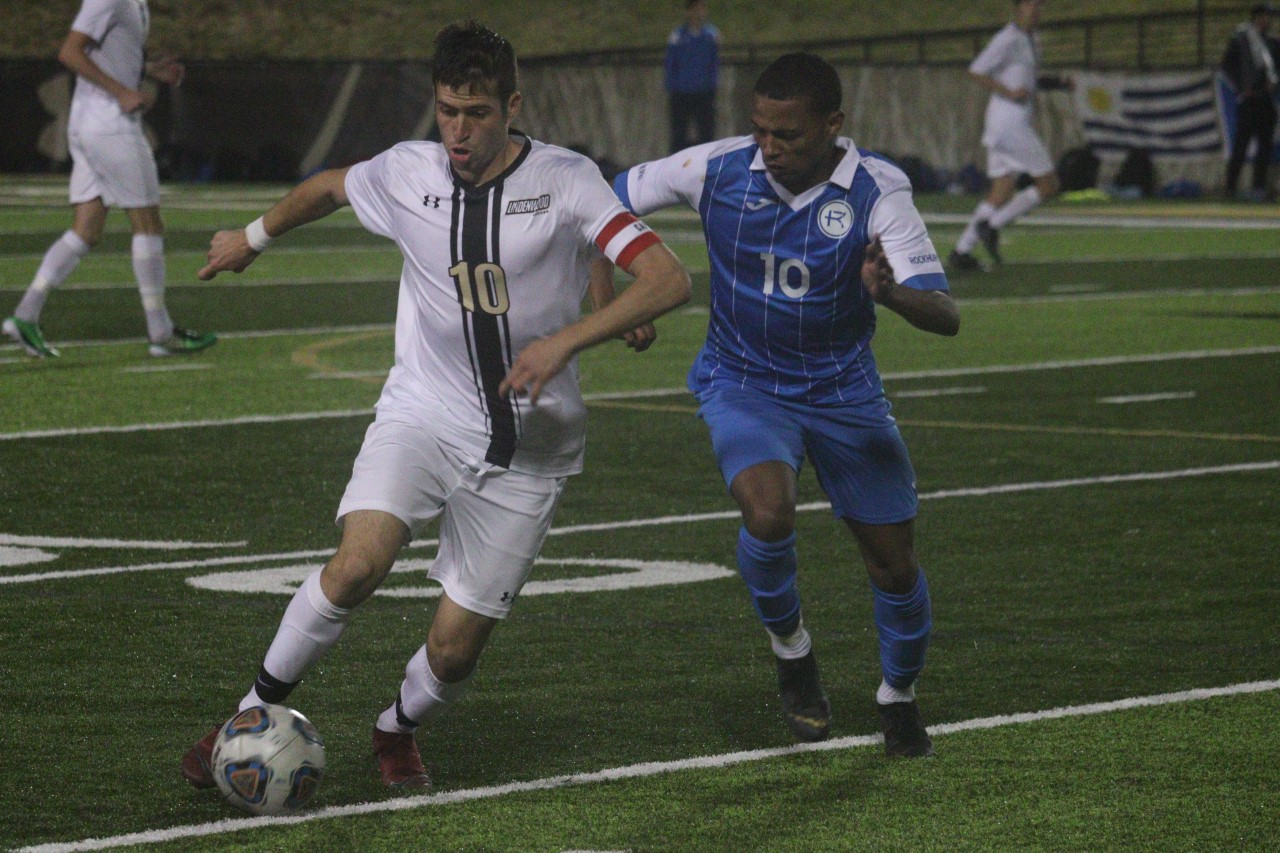 Leon Silva fights for possession of a ball against a Rockhurst University player during Friday's match at Harlen C. Hunter Stadium.  Photo by Billy Woods.