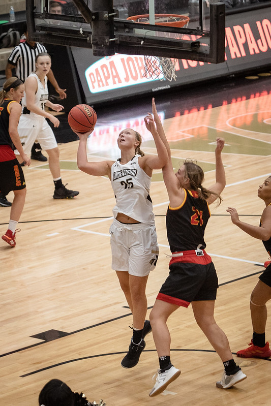 No. 25 Kallie Bildner goes for layup against a defender from Pittsburg State University.