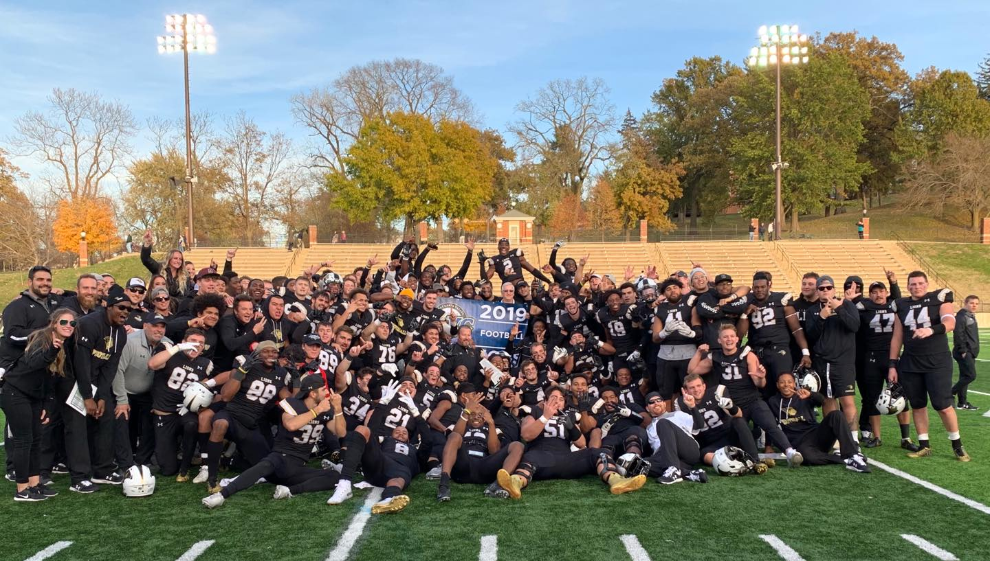 The Lindenwood football team poses in celebration after winning defeating the Miners to win the GLVC championship.