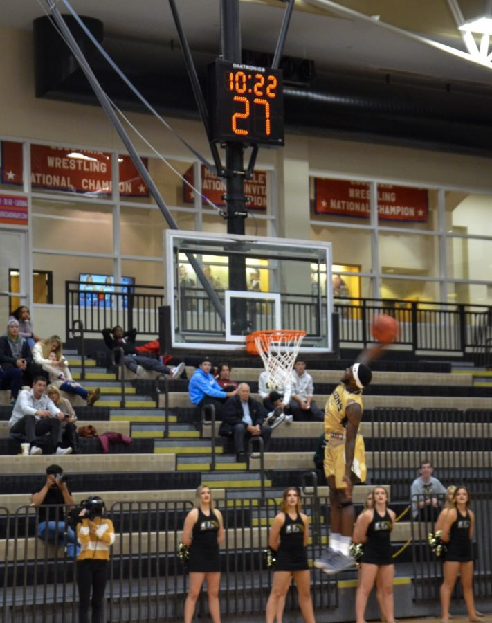 TJ Crockett dunks in the open court for a score against William Woods on Thursday night at Hyland Arena.