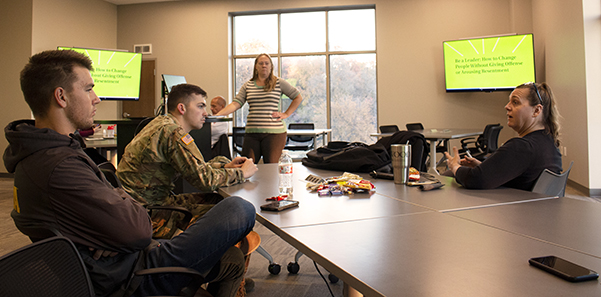 From left, Logan Rezash, Johnathan McMahon, Sarah Leassner and Tamara Deines participate in a conversation about how to win people over. This is during the