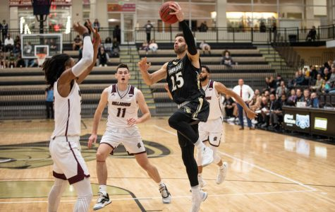 The Lion's Cameron Scales (25) lay up in front of the defender from Bellarmine on Nov. 20.