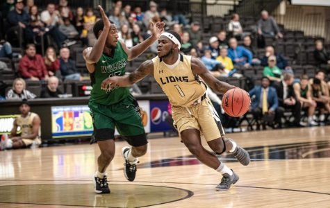Men's basketball wins home opener