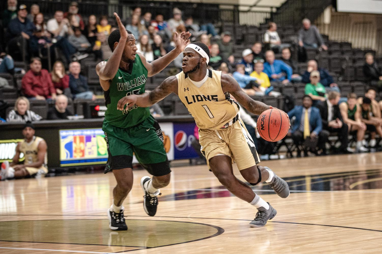 Junior T.J. Crockett (1) scored 27 points, leading the Lions to the win against William Woods. Lindenwood won 88-80.