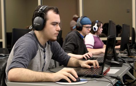 Overwatch players Joshua Coone, Sean Greenwood and Amanda Krsul work together to defeat their opponents from Florida Tech College. Greenwood serves as the in-game lead and analyst on the Overwatch team.