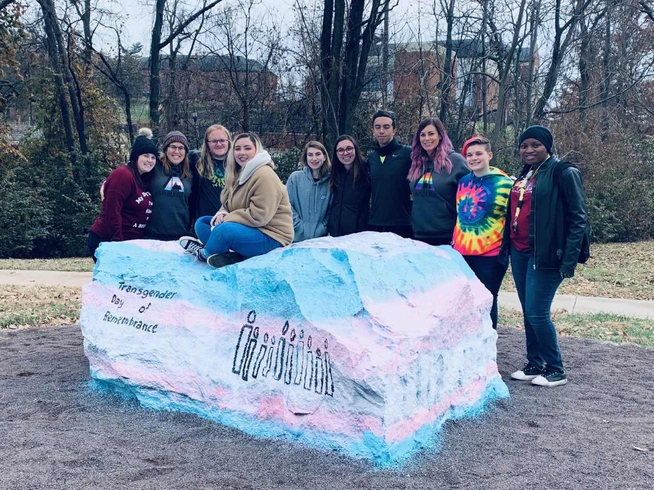 The Gender and Sexualities Alliance gathers for a photo around the Pride Rock on Nov. 17, after the slur was yelled.  Photo used with permission from Heather Brown-Hudson