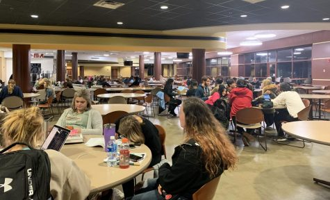 Students hang out in Spellmann Dining Hall, waiting for permission to return to their dorms on Dec. 10.