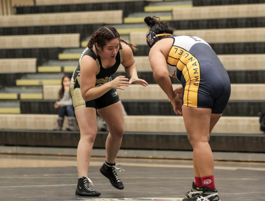 Lindenwood Senior Maya Shimizu (left) wrestles against Emmanuel College for the first home game in three years.