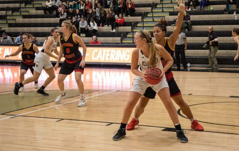Kallie Bildner (No. 25) holds the ball against a defender in a Nov. 13 contest with Pittsburg State.