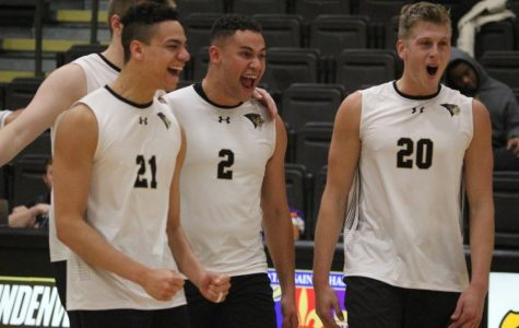 Men's volleyball players (from left) A.J. Lewis, Elijah Tabuarua, and Michael Jennings celebrate victory over Saint Francis on Jan. 17, 2020