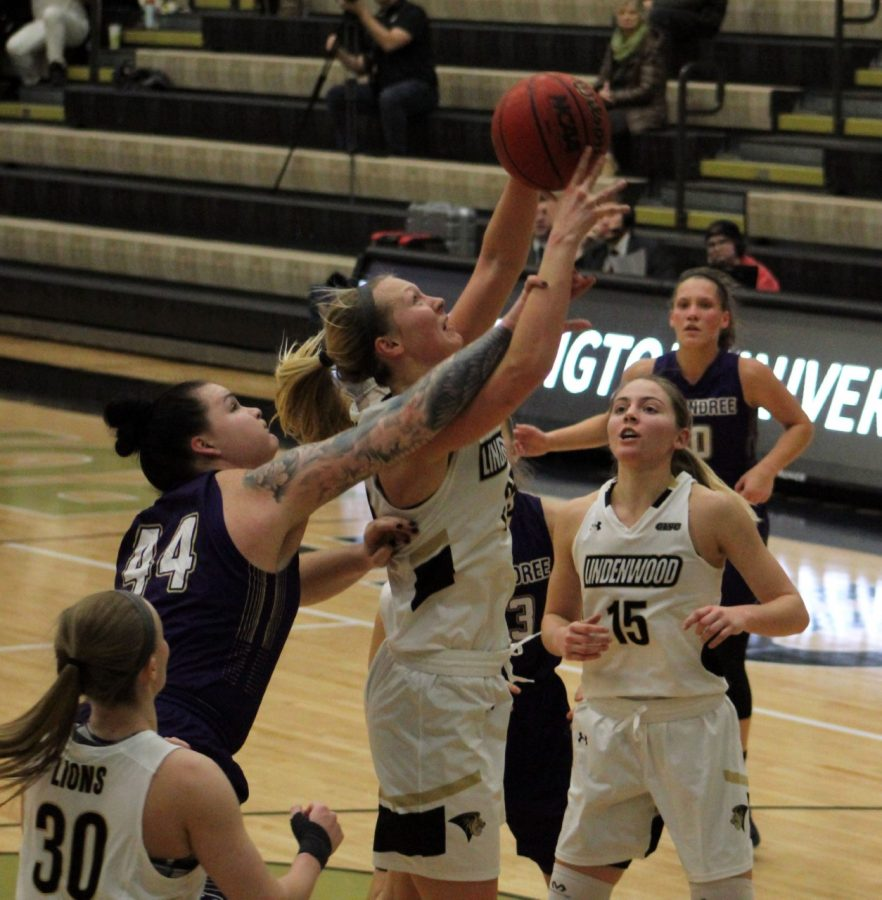 Forward Kallie Bildner jumps to make a shot during a game against McKendree University at Hyland Arena on January 30. The team secured a win with a final score of 103-74.