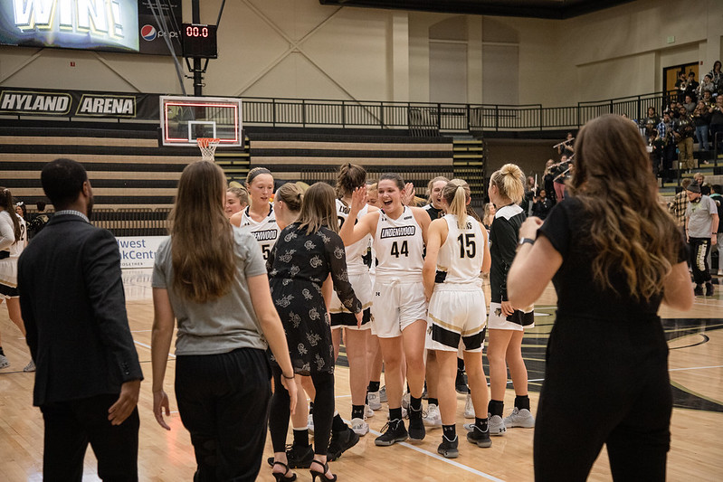 Women's basketball celebrates after a win against Pittsburg State on Nov. 13. (File photo from Nov. 13).