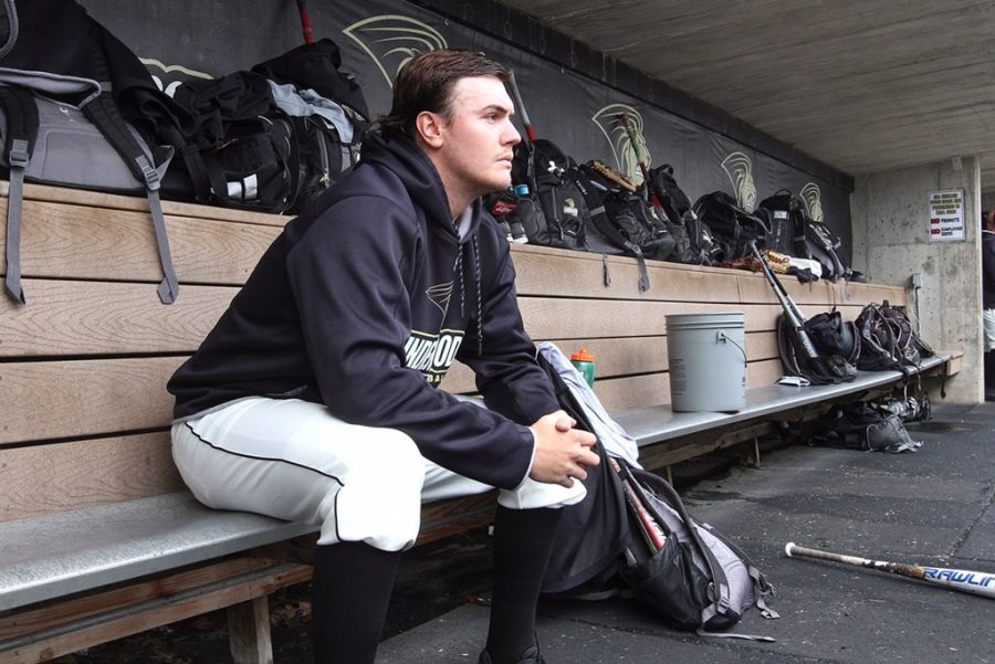Lindenwood+starter+Kyle+Hentis+reflects+in+the+dugout+during+a+practice+at+the+Lou+Brock+Sports+Complex.
