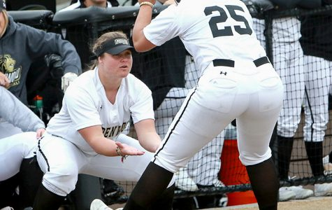 Senior Hannah Johnson goes to celebrate with her teammates in a home game for Lindenwood.