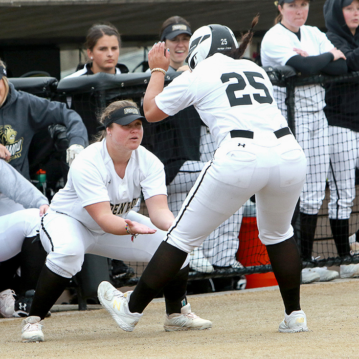Senior+Hannah+Johnson+goes+to+celebrate+with+her+teammates+in+a+home+game+for+Lindenwood.