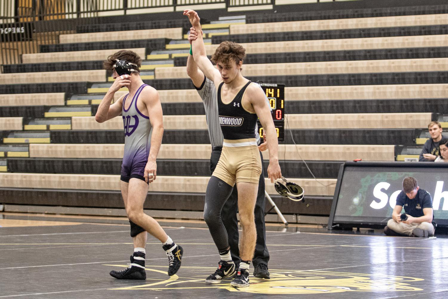 Tanner Hitchcock (right) won the match against a Panthers wrestler from Kentucky on Feb. 11 at Hyland Arena. The Lions defeated the Panthers 44-0