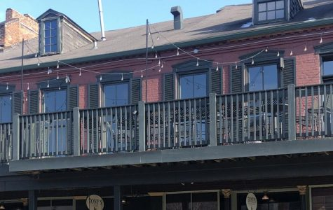 The hanging lights above the balcony of Tony's on Main Street were the subject of a recent hearing. The Landmarks Board ruled they were not allowed in a historic district, but the restaurant's owner argued the city made the decision because of personal animosity against him.