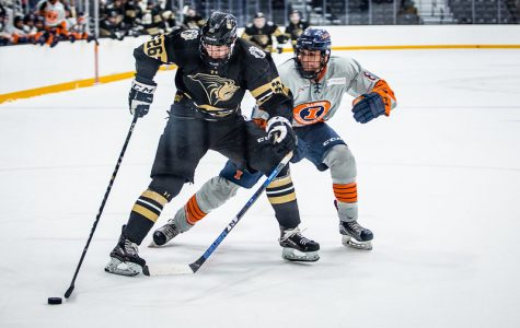 Vegard Faret (#26) battles against an Illinois defender in a home game on October 19, 2019.