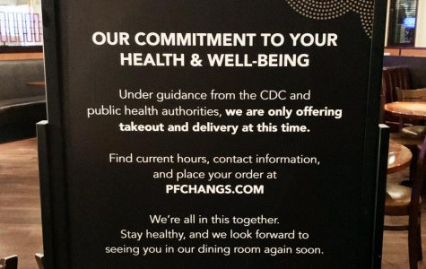 A sign at P.F. Chang's informing guests of new restrictions to dining options as a result of the coronavirus pandemic.
