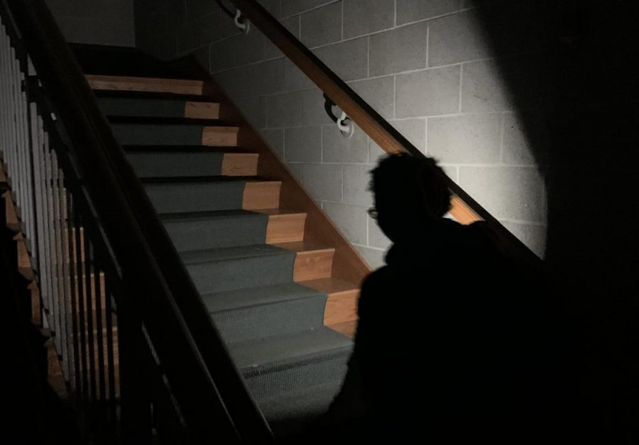Freshman Jasmine Ward uses her flashlight to walk to her room in Pfremmer Hall.