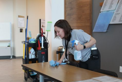 Lindenwood custodian Jennifer Swanson works to sanitize the Library and Academic Resources Center over spring break to fight the coronavirus.