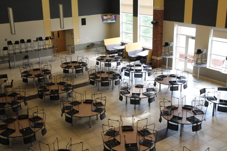 The Evans Commons dining hall, usually filled with students eating and interacting with each other, sits empty.