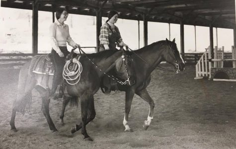 Two Lindenwood students riding horses in the 1970s in the facility that would become the Field House and Fitness Center.<br> Photo from the Mary E. Ambler Archives.