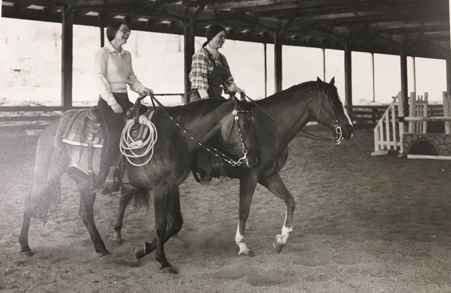 Two Lindenwood students riding horses in the 1970s in the facility that would become the Field House and Fitness Center. Photo from the Mary E. Ambler Archives.