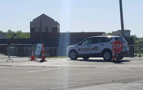 A Public Security vehicle guards the entrance to campus at First Capitol Drive on April 30.