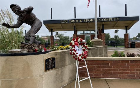 The wreath left by the family next to the Lou Brock statue at Lindenwood University on Saturday morning.