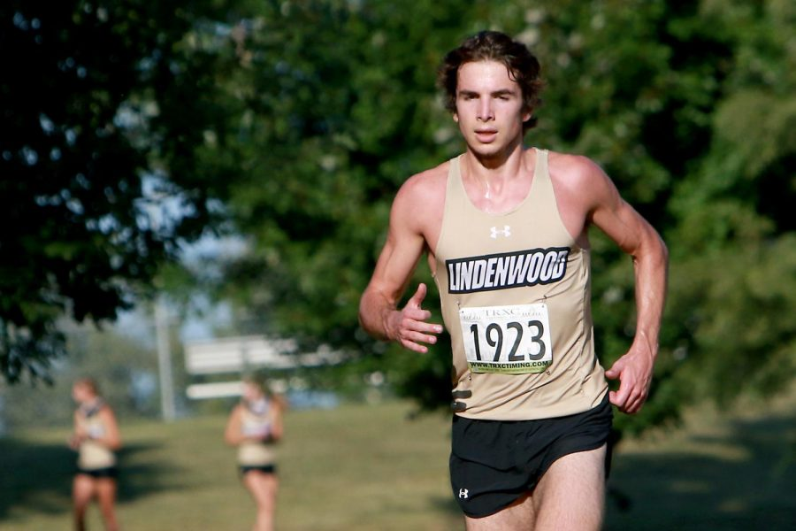Team captain Ben Stasney runs during a cross country meet for Lindenwood's men's team.
