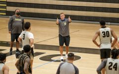 Head coach Kyle Gerdeman gives instructions to his team during a practice on October 16 in Hyland Arena.