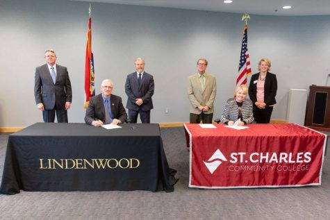 President Porter signs papers with no mask at Saint Charles Community College on Oct. 22, 2020.