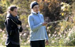 McKenna Montgomery (right) discusses her strategy with coach Abby Weber (left) in fall of 2019.