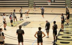 Head coach Kyle Gerdeman talks with the team during a preseason practice on Oct. 16, 2020 in Hyland Arena.