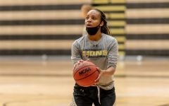 Senior guard Hennessey Handy prepares to attempt a free throw during a women's basketball practice on Friday, Nov. 13, 2020.