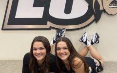 Kate and Julia Ruzevich pose on picture day in the VIP room in Hyland Arena.