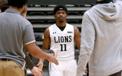 Kevin Caldwell Jr. (#11) gets greeted by members of the men's basketball team during Lindenwood's home victory against Southwest Baptist on Jan. 30.
