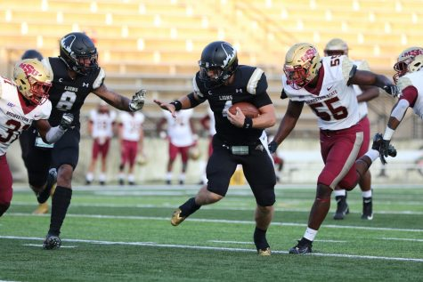 Quarterback Cade Brister (right, #4) runs past a defender and prepares for contact with another in Lindenwood