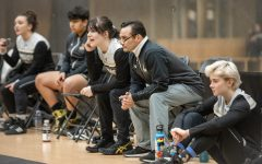 Womens wrestling head coach Mike Mena watches on from the Lindenwood bench while his team competes against MacMurray College on Jan. 24, 2020.