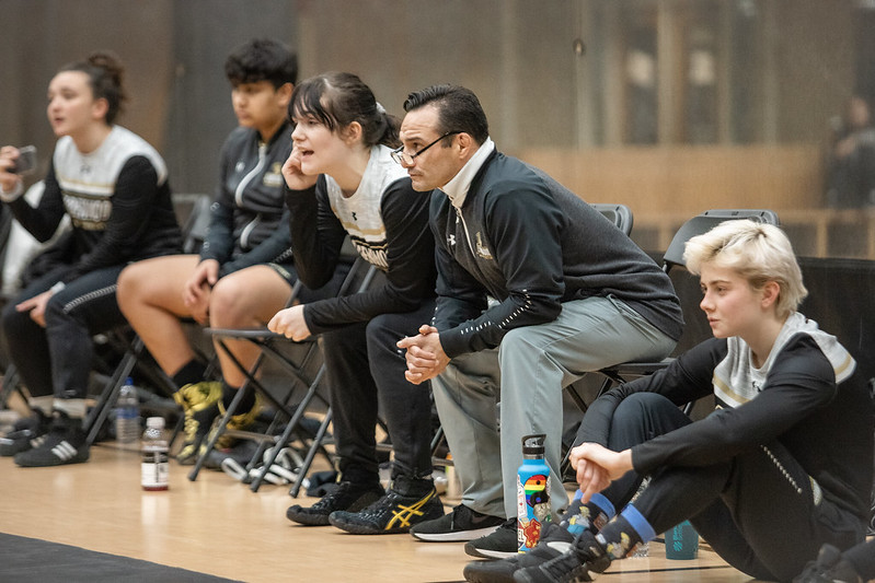 Women's wrestling head coach Mike Mena watches on from the Lindenwood bench while his team competes against MacMurray College on Jan. 24, 2020.