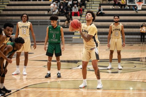 Anthony Christian (center) prepares to shoot a free throw against William Woods on Nov. 14, 2019.